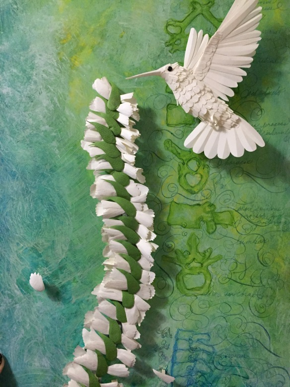 Paper hummingbird with flower spinal cord